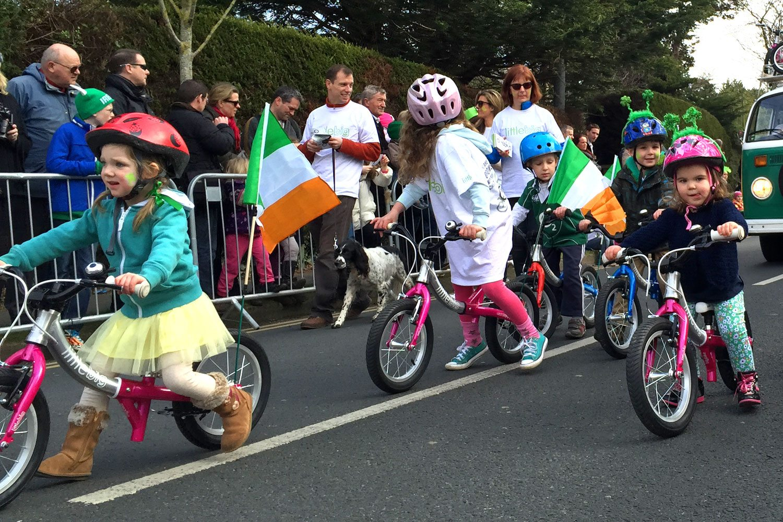 3 girls on their balance bikes at the Greystones parade