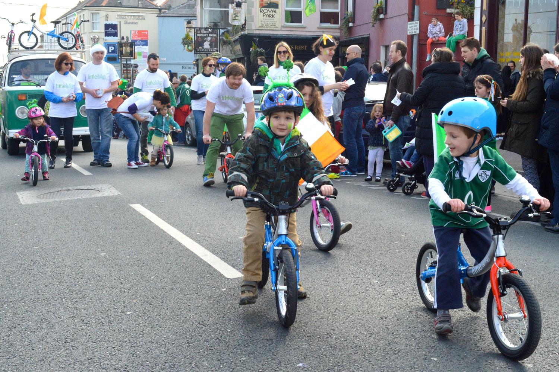 Kids on their balance bike as the St.Patrick's parade